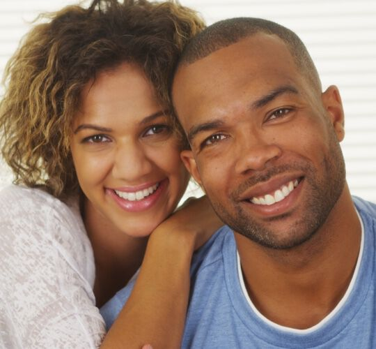 Happy Black couple smiling